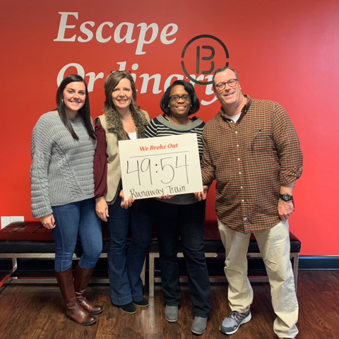 Employees completing an escape room together